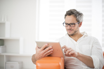 handsome man surfing on tablet