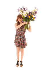 Red haired girl standing with bouquet flowers isolated over whit