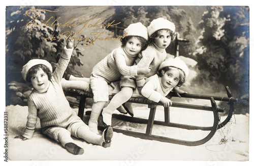 old photo of kids with sledge. vintage christmas postcard - 58872331