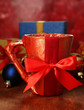 Cup packed in gift paper with gifts