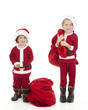 Two Boys Playing Dress Up as Santa