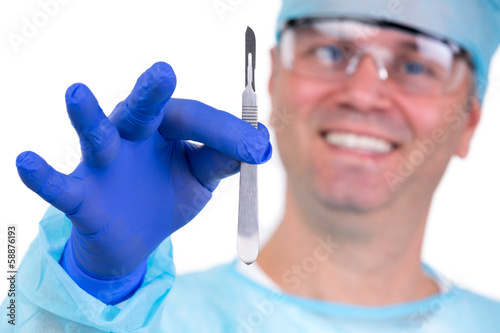 Confident Surgeon Holding Scalpel Before High Risk Surgery