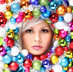 Christmas Woman with Colored Balls. Face of Beautiful Girl