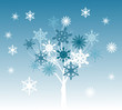 tree and snowflakes on light blue background