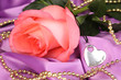 Beautiful pink rose with heart pendant