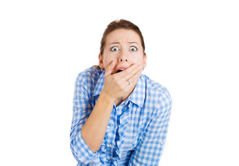 Shocked woman covering her mouth in full disbelief