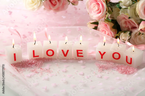 Candles with printed sign I LOVE YOU,on light background