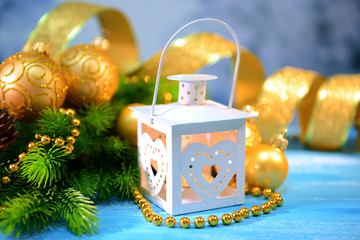 Christmas lantern, fir tree and decorations  on light