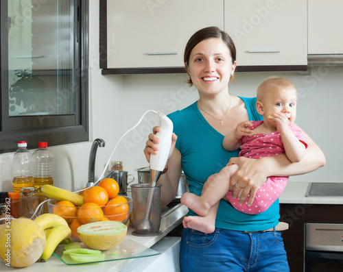 Happy woman with child    in kitchen