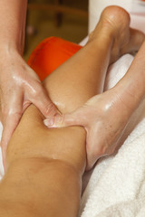 Woman receiving a professional massage and lymphatic drainage