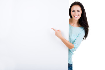 Happy smiling beautiful young woman showing blank signboard