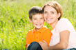Leinwanddruck Bild - Happy mother and son outdoor portrait