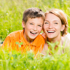 Happy mother and son in park