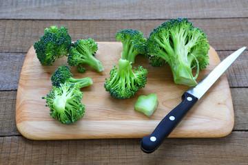 fresh broccoli on cutting board