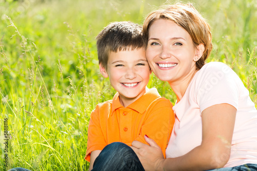 Leinwanddruck Bild Happy mother and son outdoor portrait