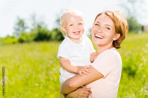 Happy mother and toddler son outdoor portrait