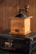 Old coffee mill  grinder on retro suitcase