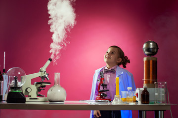 Girl watching successful progress of experiment