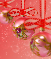 image of beautiful pink Christmas balls hanging on ribbons