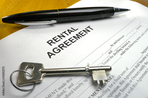 pen and key on rental agreement