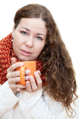 Young sick woman with a cup of tea in her hand isolated on white