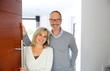 Leinwanddruck Bild - Senior couple welcoming people to enter home