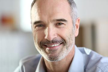 Closeup of handsome senior man with grey hair