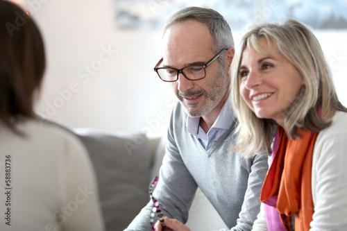 Leinwanddruck Bild Senior couple meeting financial adviser for investment