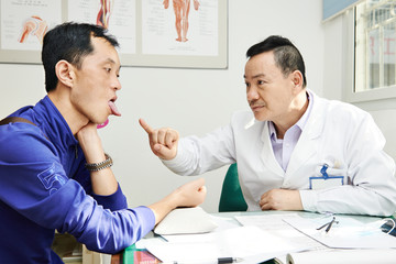 Chinese asian male doctor at work
