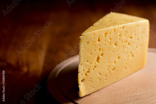 Wedge of cheese on a cheese board
