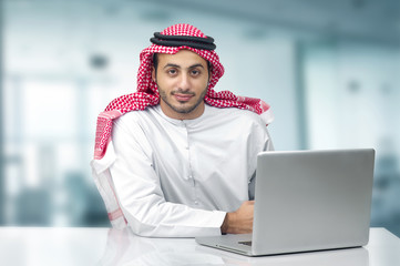 Arabian Business man using notebook in the office