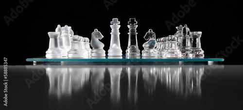 Leinwanddruck Bild glass chess board with chess pieces