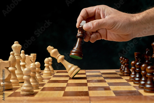wooden chess board with chess pieces on.