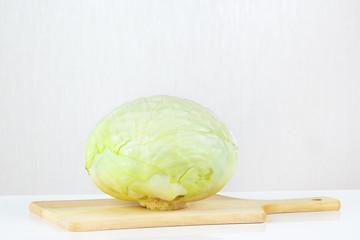 Fresh raw cabbage on a cutting board closeup