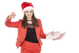 unsatisfied business woman with santa hat, holding a present