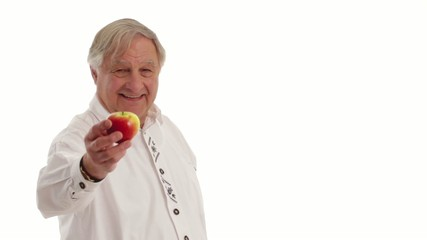 senior citizen male eats apple