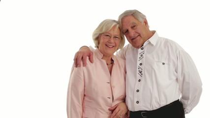 senior couple holding each other