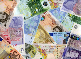 Euro and United Kingdom banknotes (pound) background