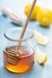 honey and lemon over blue background