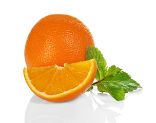 The whole and slice of orange with mint