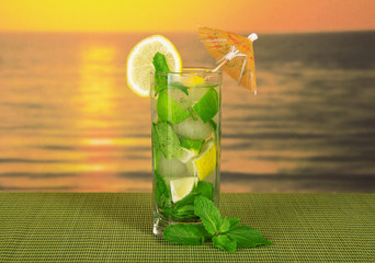 Mojito on sea sunset background