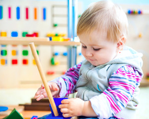 little girl in the classroom early development