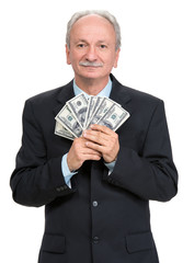 Senior businessman holding group of dollars