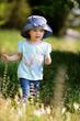 girl walking in grass