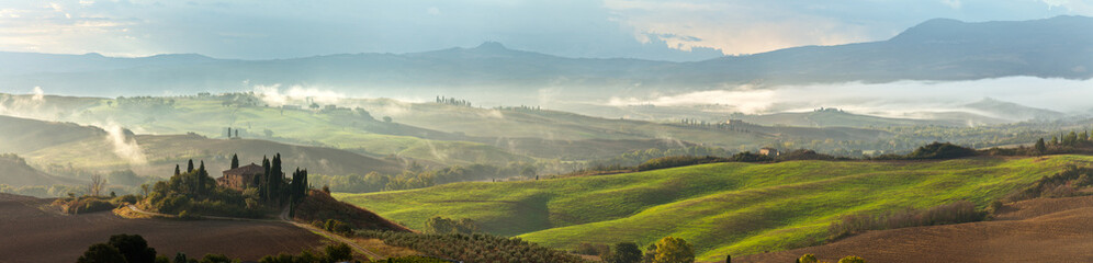 Val d'Orcia on a misty morning. Tuscany. Italy. Panorama