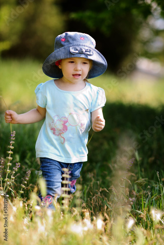 girl walking in grass
