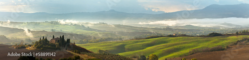 Val d'Orcia on a misty morning. Tuscany. Italy. Panorama - 58891142
