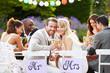 Bride And Groom Enjoying Meal At Wedding Reception - 58891717