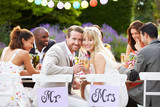Fototapety Bride And Groom Enjoying Meal At Wedding Reception