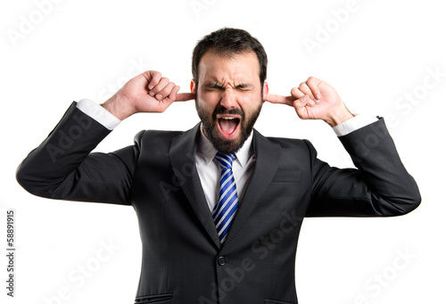 business man covering her ears over white background